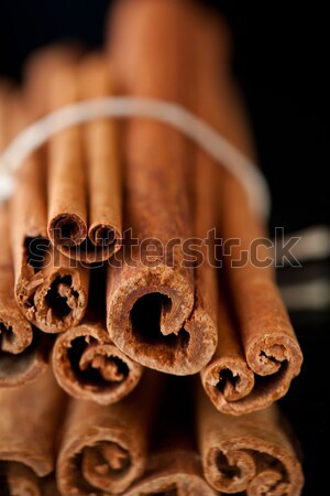Six cinnamon sticks packed together against a black background Stock photo © wavebreak_media
