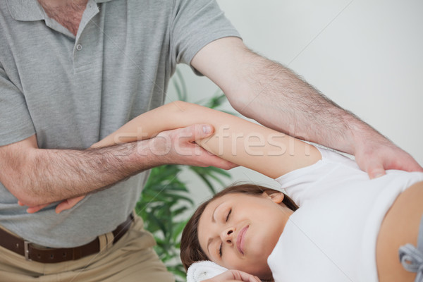 Woman being stretched while lying on a table in a room Stock photo © wavebreak_media