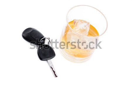 Tumbler glass with whiskey with car key and handcuff against a white background Stock photo © wavebreak_media