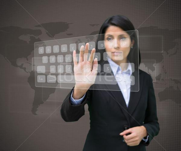 Businesswoman typing on projected digital keyboard Stock photo © wavebreak_media