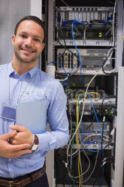 Man standing in front of  data servers and smiling Stock photo © wavebreak_media