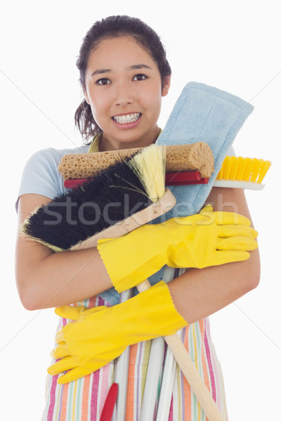 Woman narly dropping her mops and brushes Stock photo © wavebreak_media