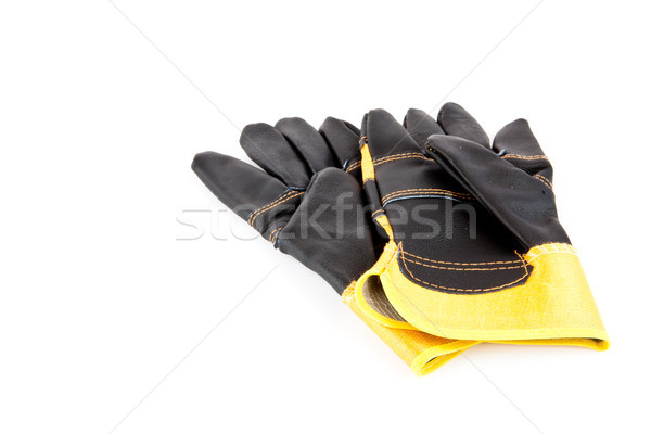 Black and yellow builder's gloves Stock photo © wavebreak_media