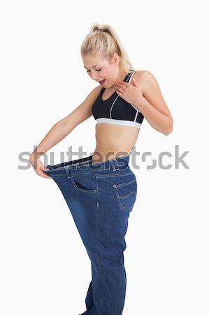 Jovem fino mulher velho calças Foto stock © wavebreak_media