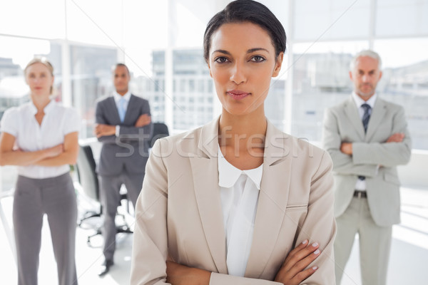 Attractive serious businesswoman with arms crossed  Stock photo © wavebreak_media