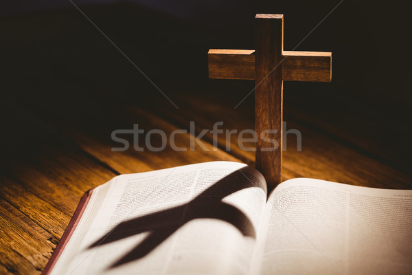 Open bible with crucifix icon behind Stock photo © wavebreak_media