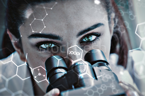 Composite image of close up of a scientist posing with a microsc Stock photo © wavebreak_media