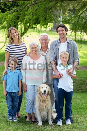 Extended family with their pet dog at park Stock photo © wavebreak_media