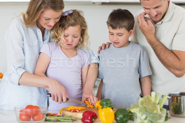 Family chopping vegetables in kitchen Stock photo © wavebreak_media