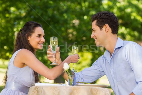 пару шампанского флейты сидят Открытый улыбаясь Сток-фото © wavebreak_media