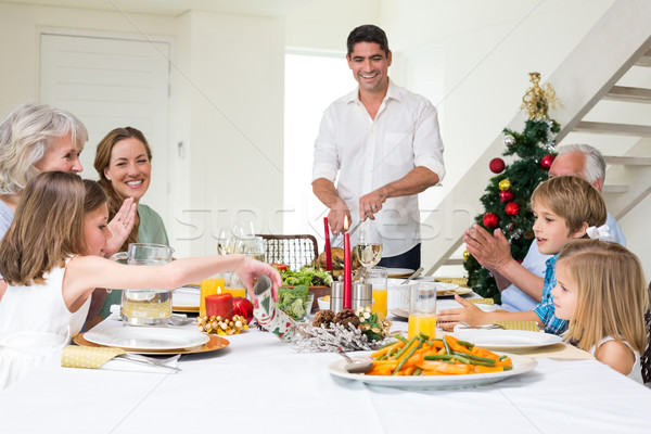 Família natal refeição mesa de jantar feliz Foto stock © wavebreak_media