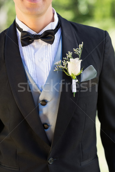 Midsection of groom wearing boutonniere Stock photo © wavebreak_media