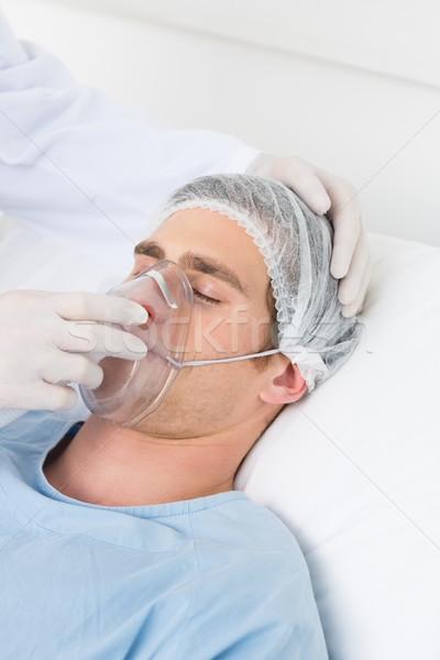 Doctor adjusting oxygen mask on male patient Stock photo © wavebreak_media