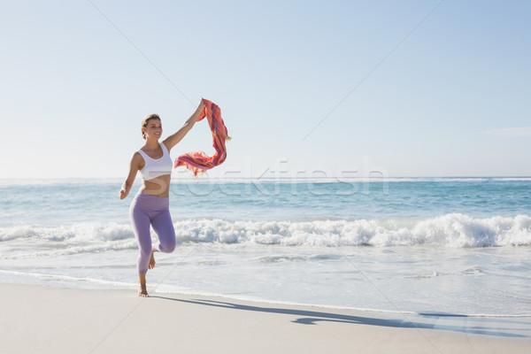 Blond jogging strand sjaal Stockfoto © wavebreak_media