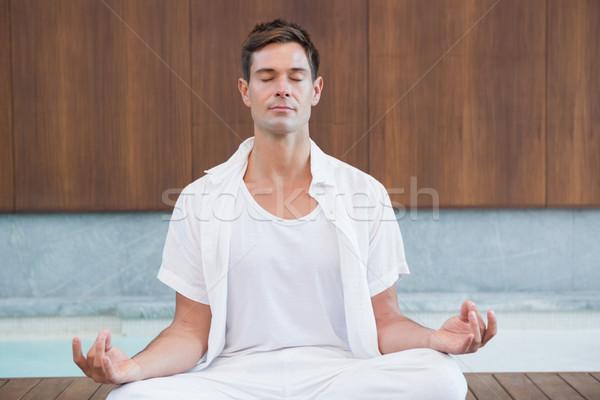 Jóképű férfi fehér meditál lótusz póz gyógyfürdő Stock fotó © wavebreak_media
