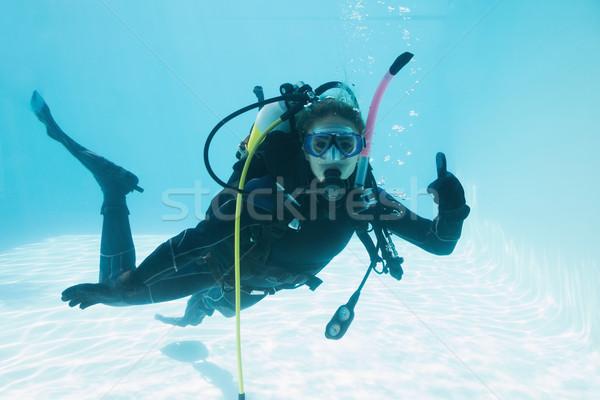 Kadın skuba eğitim yüzme havuzu başparmak Stok fotoğraf © wavebreak_media