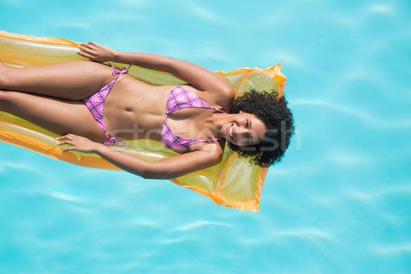 Feliz mujer piscina hotel libertad Foto stock © wavebreak_media