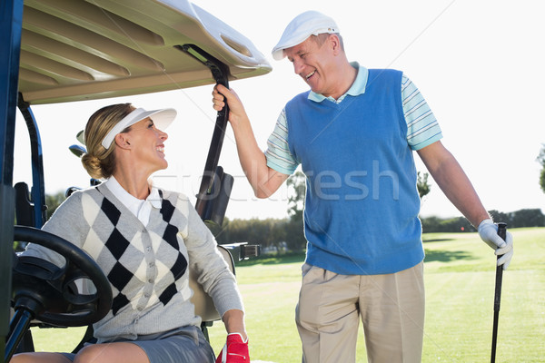 Happy golfing couple setting out for the day on buggy Stock photo © wavebreak_media