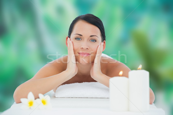 Stock photo: Beautiful brunette relaxing on massage table smiling at camera