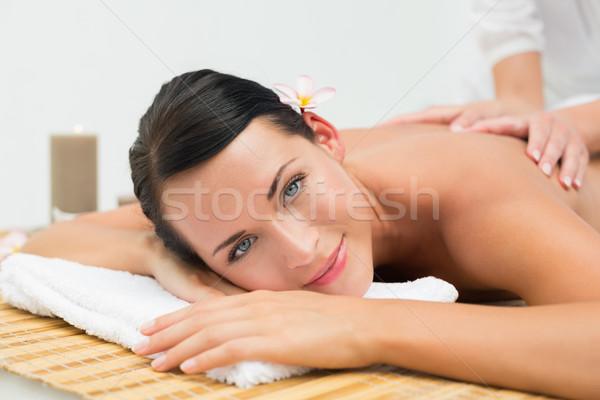 Friedlich Brünette genießen zurück Massage lächelnd Stock foto © wavebreak_media