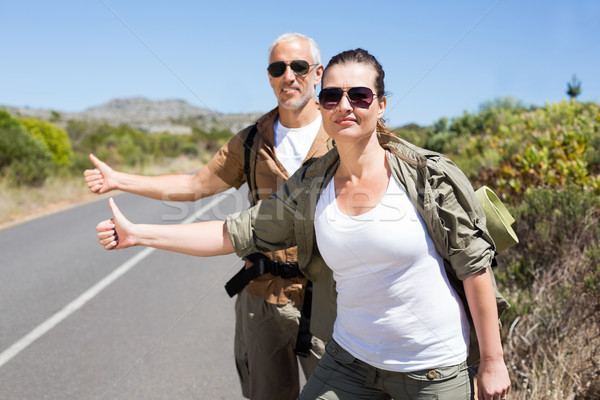 Hitch hiking couple standing on the side of the road with thumb  Stock photo © wavebreak_media