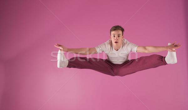 Cool break dancer mid air doing the splits Stock photo © wavebreak_media