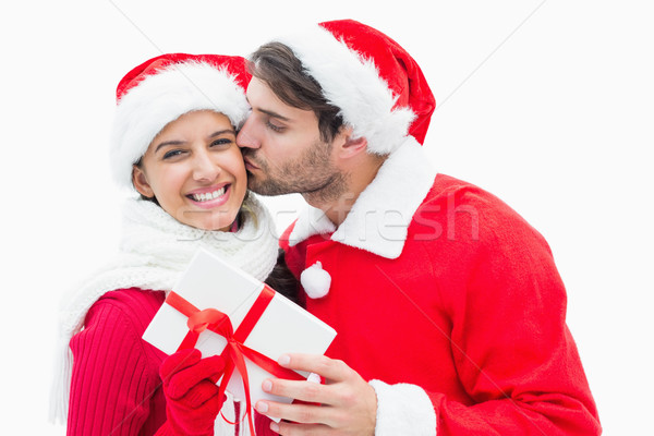 Attractive festive man giving girlfriend a kiss and present Stock photo © wavebreak_media