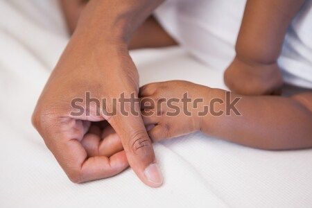 Father napping with baby son on couch Stock photo © wavebreak_media