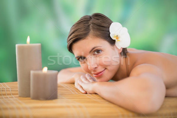 Beautiful woman on massage table at health farm Stock photo © wavebreak_media