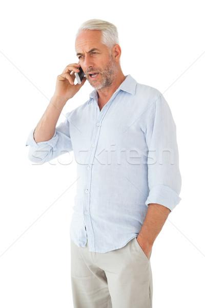 Poważny człowiek mówić telefonu biały telefonu komórkowego Zdjęcia stock © wavebreak_media