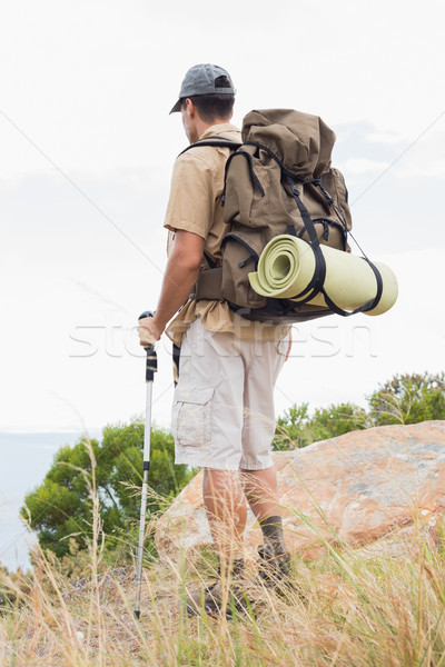 Hiking man walking on mountain terrain Stock photo © wavebreak_media