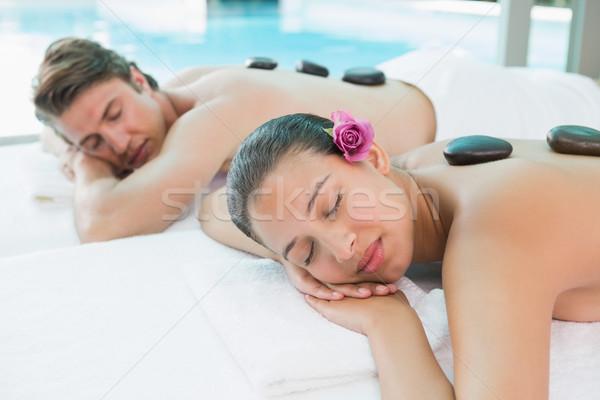 Couple enjoying stone massage at health farm Stock photo © wavebreak_media