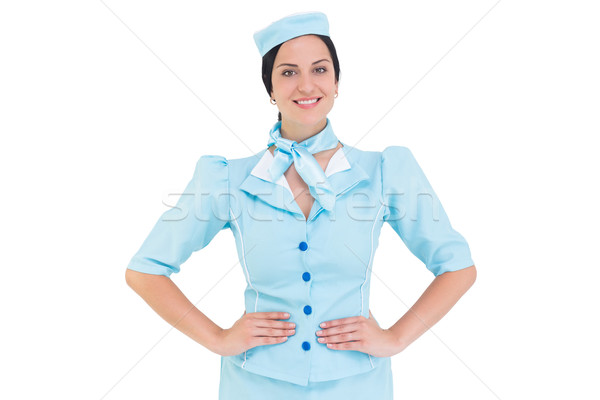 Pretty air hostess smiling at camera Stock photo © wavebreak_media