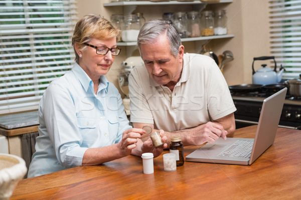 Senior couple looking up medication online Stock photo © wavebreak_media