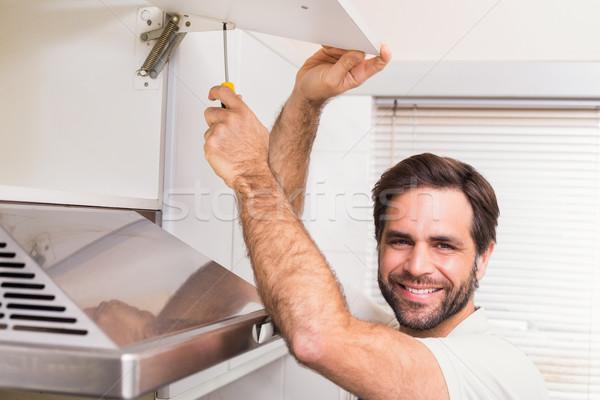 мастер на все руки вверх шельфа кухне человека рабочих Сток-фото © wavebreak_media