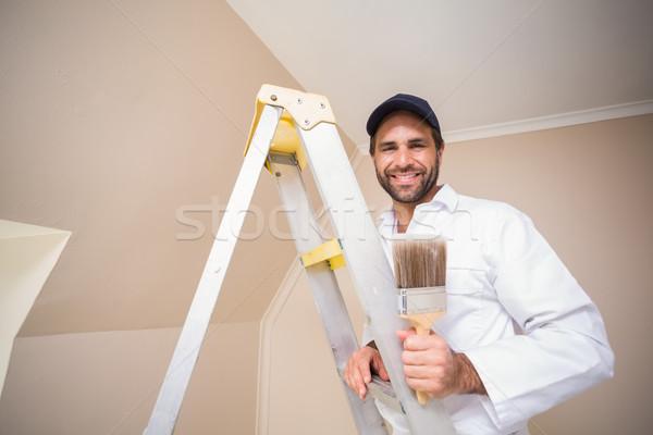画家 笑みを浮かべて 立って はしご 家 ストックフォト © wavebreak_media
