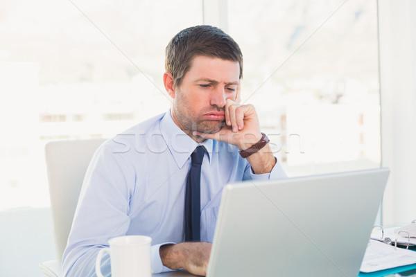 путать бизнесмен глядя ноутбука служба компьютер Сток-фото © wavebreak_media