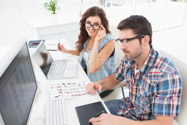 Equipe de negócios trabalhando laptop reunião projeto equipe Foto stock © wavebreak_media