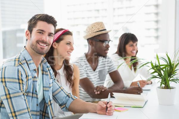 Souriant travail d'équipe écouter prendre des notes bureau réunion Photo stock © wavebreak_media
