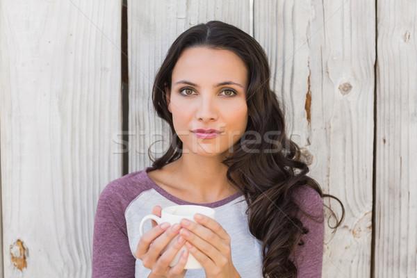 Pretty brunette holding a mug Stock photo © wavebreak_media