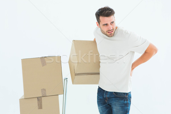 Delivery man with cardboard boxes suffering from backach Stock photo © wavebreak_media