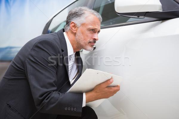 Odaklı işadamı bakıyor araba vücut yeni araç Stok fotoğraf © wavebreak_media
