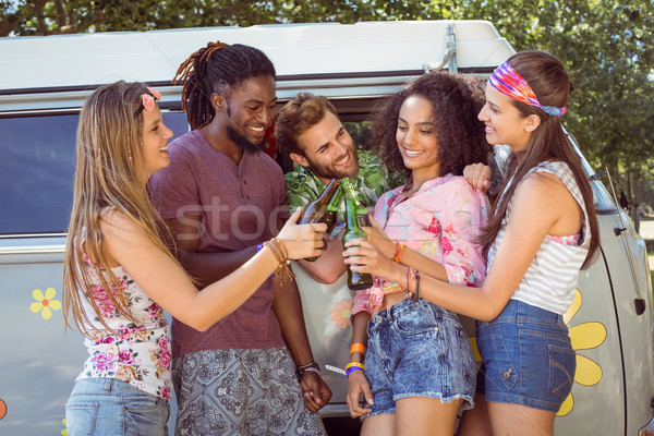Happy hipsters toasting their beer bottles Stock photo © wavebreak_media