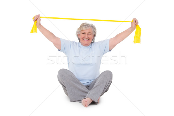 Senior woman using resistance band Stock photo © wavebreak_media