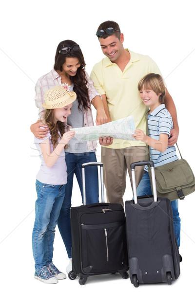 Aile bagaj keşfetmek harita mutlu aile beyaz Stok fotoğraf © wavebreak_media