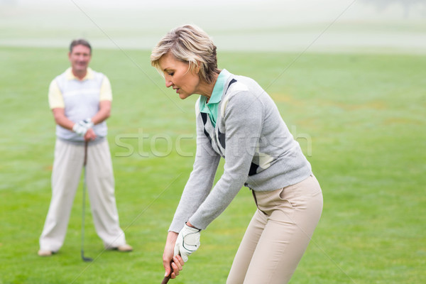 Lady golfer teeing off for the day watched by partner Stock photo © wavebreak_media