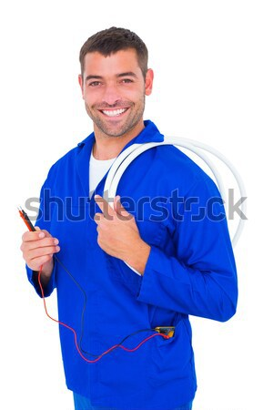 Smiling electrician with wire roll and multimeter Stock photo © wavebreak_media
