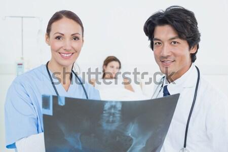 Hard working doctors reviewing notes Stock photo © wavebreak_media