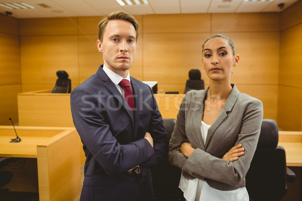 Unsmiling lawyers looking at camera crossed arms  Stock photo © wavebreak_media