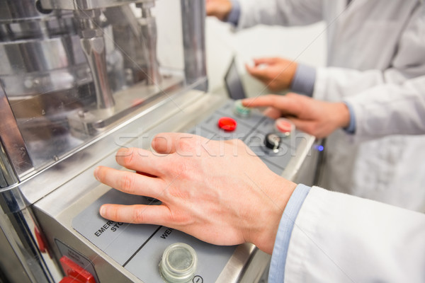 Pharmacist pressing button on machine Stock photo © wavebreak_media